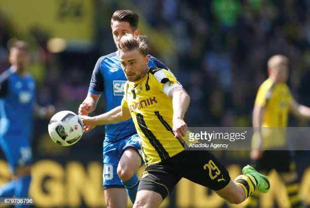 Marcel Schmelzer of Dortmund and Mark Uth of Hoffenheim fight for the ball during the Bundesliga soccer match between Borussia Dortmund and TSG...