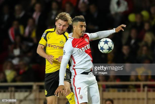 Marcel Schmelzer of Dortmund and Nabil Dirar of Monaco battle for the ball during the UEFA Champions League quarter final second leg match between AS...