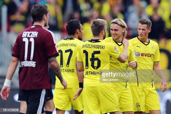 Marcel Schmelzer of Dortmund celebrates his team's first goal with team mates PierreEmerick Aubameyang Jakub Blaszczykowski and Erik Durm during the...