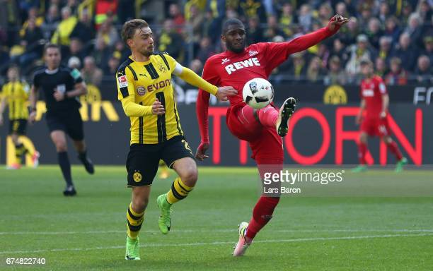 Marcel Schmelzer of Dortmund challenges Anthony Modeste of Koeln during the Bundesliga match between Borussia Dortmund and 1 FC Koeln at Signal Iduna...