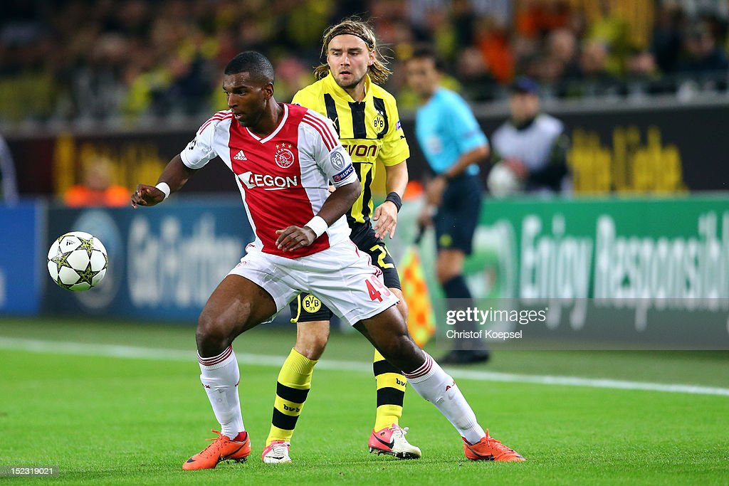 <a gi-track='captionPersonalityLinkClicked' href=/galleries/search?phrase=Marcel+Schmelzer&family=editorial&specificpeople=5443925 ng-click='$event.stopPropagation()'>Marcel Schmelzer</a> of Dortmund (R) challenges <a gi-track='captionPersonalityLinkClicked' href=/galleries/search?phrase=Ryan+Babel&family=editorial&specificpeople=543539 ng-click='$event.stopPropagation()'>Ryan Babel</a> of Amsterdam (L) during the UEFA Champions League group D match between Borussia Dortmund and Ajax Amsterdam at Signal Iduna Park on September 18, 2012 in Dortmund, Germany.