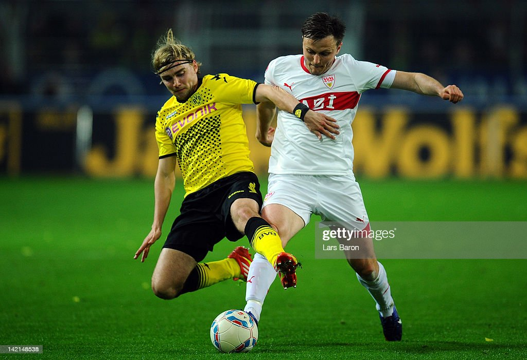 <a gi-track='captionPersonalityLinkClicked' href=/galleries/search?phrase=Marcel+Schmelzer&family=editorial&specificpeople=5443925 ng-click='$event.stopPropagation()'>Marcel Schmelzer</a> of Dortmund challenges <a gi-track='captionPersonalityLinkClicked' href=/galleries/search?phrase=William+Kvist&family=editorial&specificpeople=2465270 ng-click='$event.stopPropagation()'>William Kvist</a> of Stuttgart during the Bundesliga match between Borussia Dortmund and VfB Stuttgart at Signal Iduna Park on March 30, 2012 in Dortmund, Germany.
