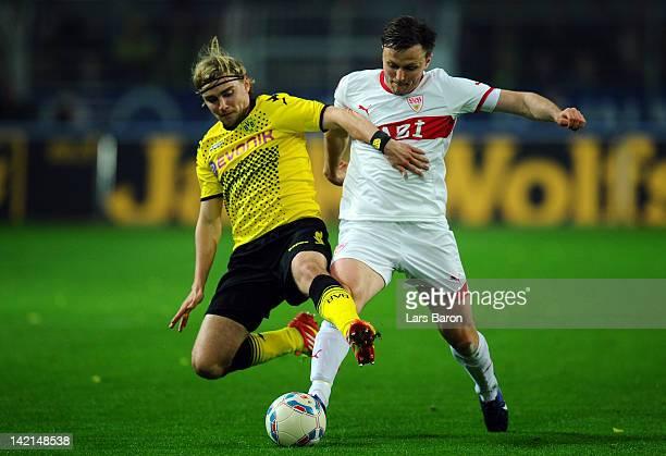 Marcel Schmelzer of Dortmund challenges William Kvist of Stuttgart during the Bundesliga match between Borussia Dortmund and VfB Stuttgart at Signal...