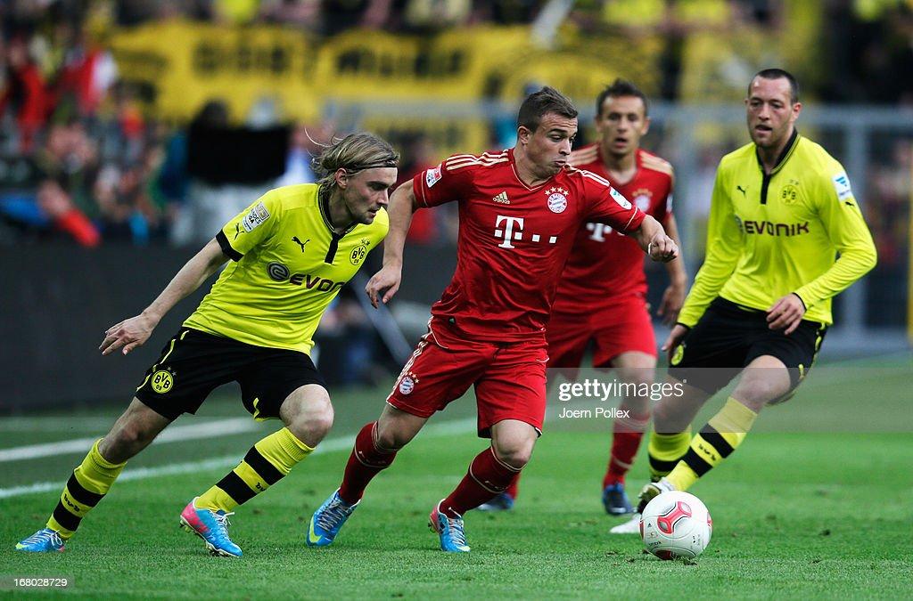 Marcel Schmelzer (L) of Dortmund challenges Xherdan Shaqiri of Muenchen during the Bundesliga match between Borussia Dortmund and FC Bayern Muenchen at Signal Iduna Park on May 4, 2013 in Dortmund, Germany.