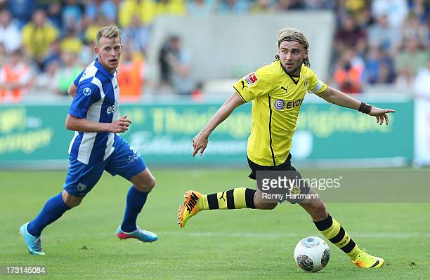 Marcel Schmelzer of Dortmund competes with Tino Schmunck of Magdeburg during preseason friendly match between 1 FC Magdeburg and Borussia Dortmund at...