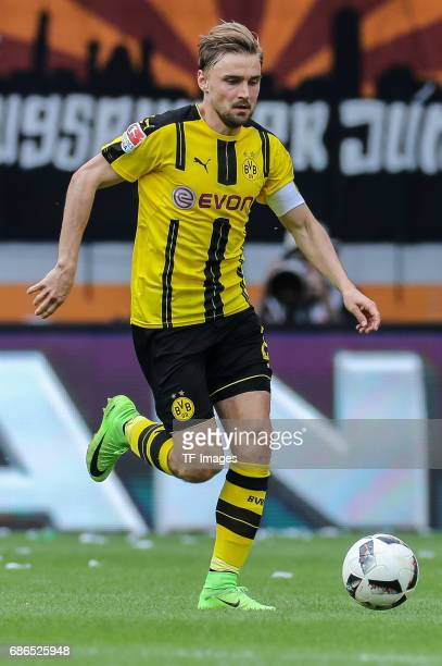 Marcel Schmelzer of Dortmund controls the ball during the Bundesliga match between FC Augsburg and Borussia Dortmund at the WWKArena on May 13 2017...