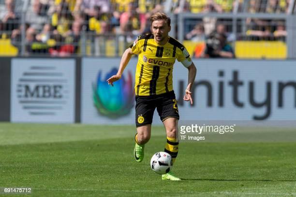 Marcel Schmelzer of Dortmund controls the ball during the Bundesliga match between Borussia Dortmund and TSG 1899 Hoffenheim at Signal Iduna Park on...