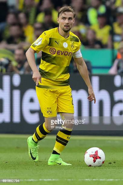 Marcel Schmelzer of Dortmund controls the ball during the DFB Cup final match between Eintracht Frankfurt and Borussia Dortmund at Olympiastadion on...