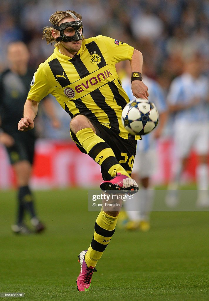 <a gi-track='captionPersonalityLinkClicked' href=/galleries/search?phrase=Marcel+Schmelzer&family=editorial&specificpeople=5443925 ng-click='$event.stopPropagation()'>Marcel Schmelzer</a> of Dortmund in action during the UEFA Champion League quarter final first leg match between Malaga CF and Borussia Dortmund at La Rosaleda Stadium on April 3, 2013 in Malaga, Spain.