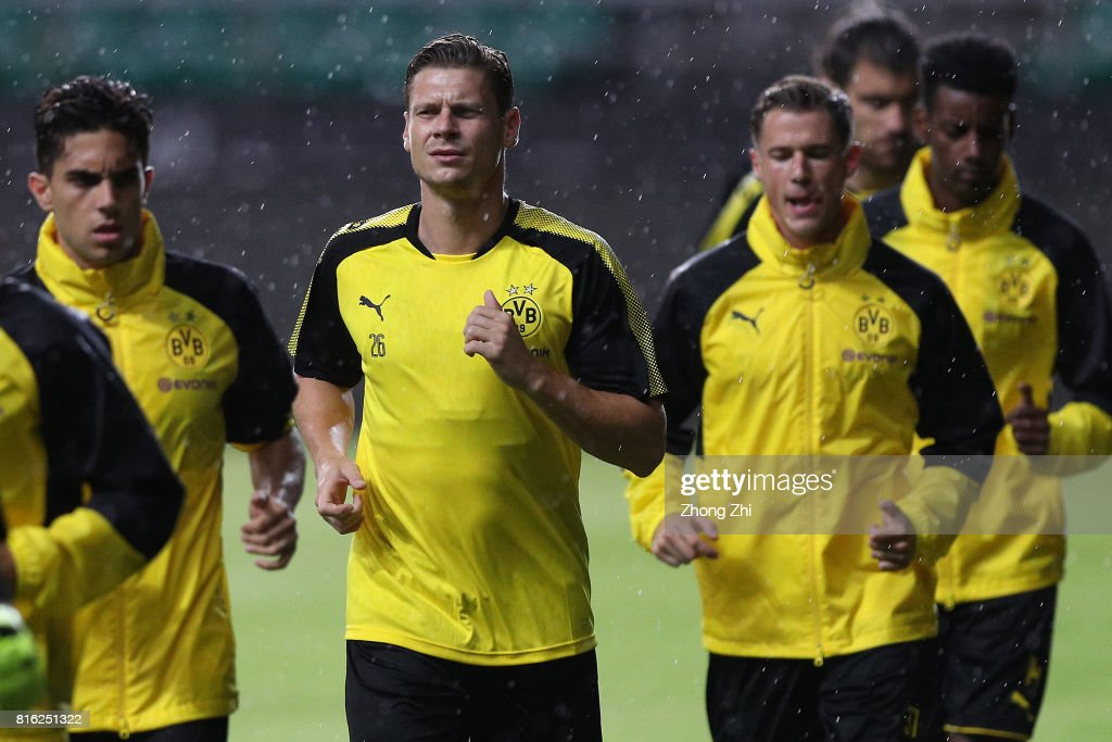 Marcel Schmelzer of Dortmund(L-2) in action during training session ahead of the 2017 International Champions Cup football match between AC Milan and Borussia Dortmund at University Town Sports Centre Stadium on July 17, 2017 in Guangzhou, China.