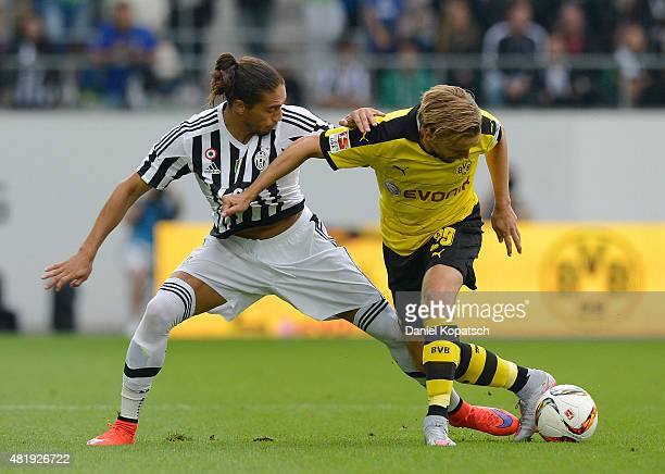 Marcel Schmelzer of Dortmund is challenged by Martin Caceres of Juventus during the friendly match between Juventus and Borussia Dortmund on July 25...