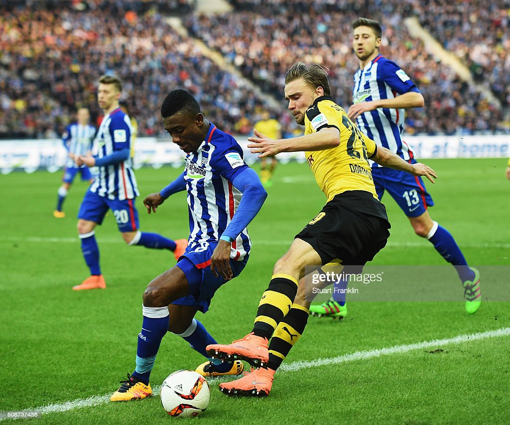 Marcel Schmelzer of Dortmund is challenged by Salomon Kalou of Berlin during the Bundesliga match bewteen Hertha BSC and Borussia Dortmund at Olympiastadion on February 6, 2016 in Berlin, Germany.