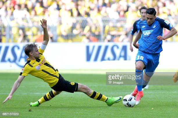 Marcel Schmelzer of Dortmund Nadiem Amiri of Hoffenheim battle for the ball during the Bundesliga match between Borussia Dortmund and TSG 1899...