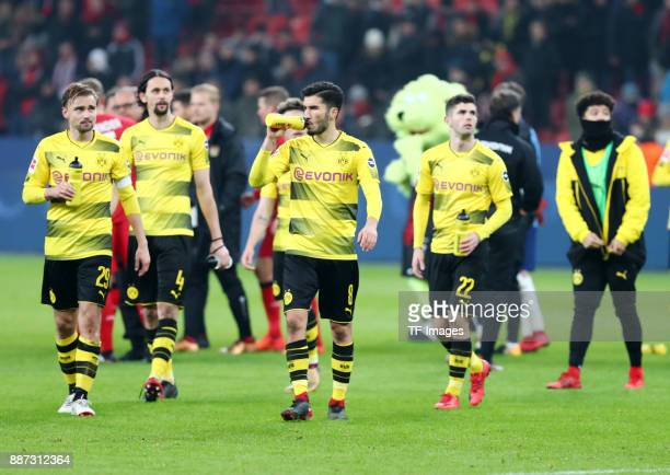 Marcel Schmelzer of Dortmund Neven Subotic of Dortmund Nuri Sahin of Dortmund Christian Pulisic of Dortmund and Jadon Sancho of Dortmund look...
