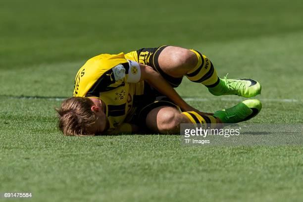 Marcel Schmelzer of Dortmund on the ground during the Bundesliga match between Borussia Dortmund and TSG 1899 Hoffenheim at Signal Iduna Park on May...