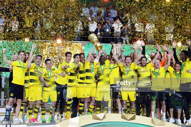 Marcel Schmelzer of Dortmund players celebrate with the trophy during at Olympiastadion on May 27 2017 in Berlin Germany