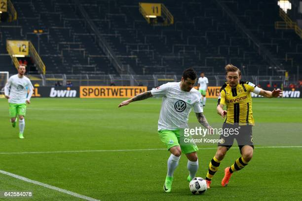 Marcel Schmelzer of Dortmund0 challenges Vieirinha of Wolfsburg during the Bundesliga match between Borussia Dortmund and VfL Wolfsburg at Signal...