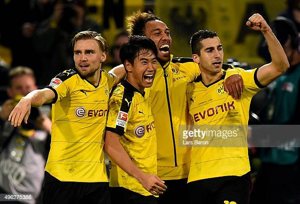 Marcel Schmelzer Shinji Kagawa PierreEmerick Aubameyang and Henrikh Mkhitaryan of Dortmund celebrates after winning the Bundesliga match between...