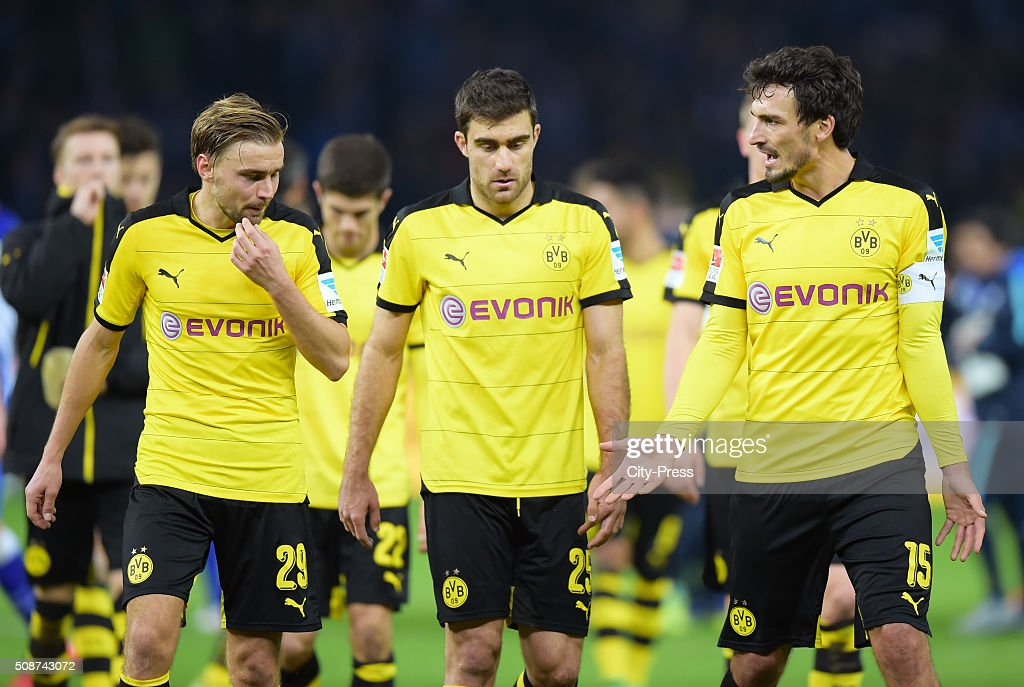 <a gi-track='captionPersonalityLinkClicked' href=/galleries/search?phrase=Marcel+Schmelzer&family=editorial&specificpeople=5443925 ng-click='$event.stopPropagation()'>Marcel Schmelzer</a>, <a gi-track='captionPersonalityLinkClicked' href=/galleries/search?phrase=Sokratis+Papastathopoulos+-+Soccer+Player&family=editorial&specificpeople=4426771 ng-click='$event.stopPropagation()'>Sokratis Papastathopoulos</a> and <a gi-track='captionPersonalityLinkClicked' href=/galleries/search?phrase=Mats+Hummels&family=editorial&specificpeople=595395 ng-click='$event.stopPropagation()'>Mats Hummels</a> of Borussia Dortmund after the game between Hertha BSC and Borussia Dortmund on February 6, 2016 in Berlin, Germany.