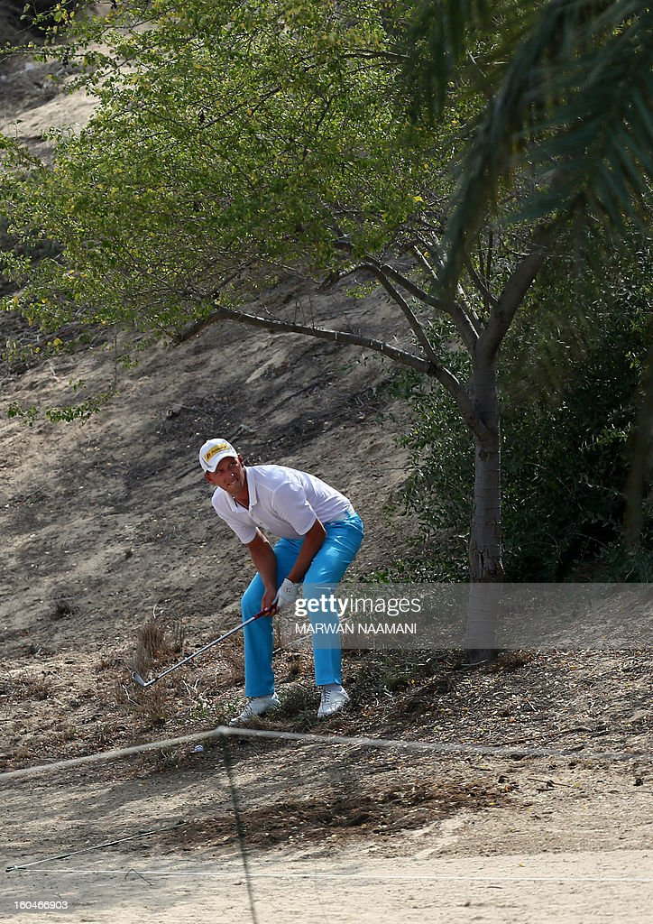 Marcel Seim of Germany gestures before playing a shot during the second round of the Dubai Desert Classic golf tournament in the Gulf emirate of Dubai on February 1, 2013. AFP PHOTO/MARWAN NAAMANI