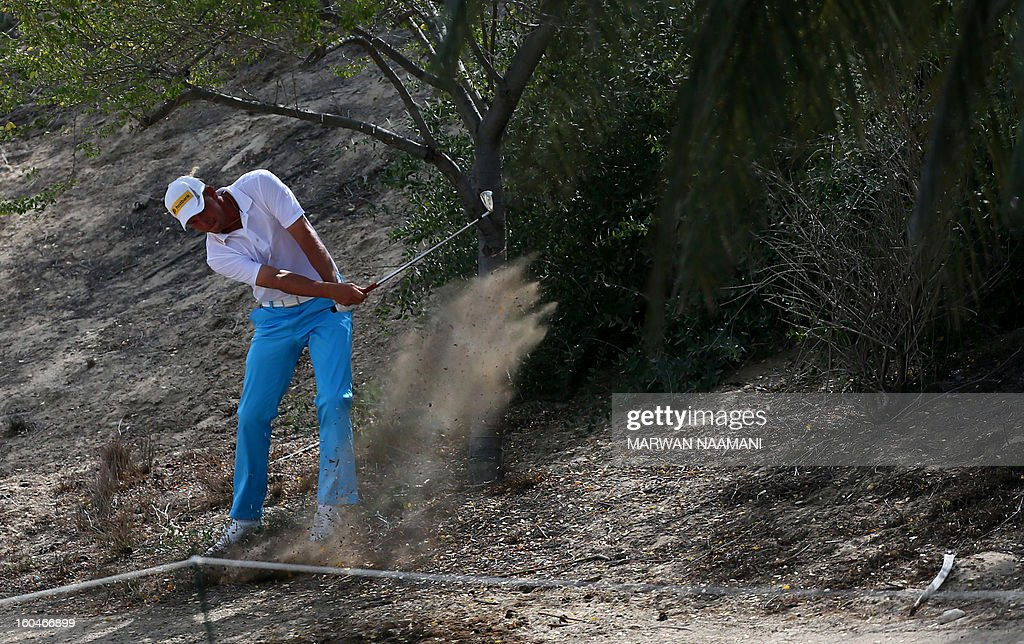 Marcel Seim of Germany plays a shot during the second round of the Dubai Desert Classic golf tournament in the Gulf emirate of Dubai on February 1, 2013.