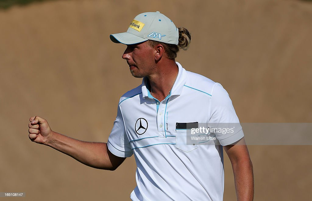 Marcel Siem of Germany acknowledges the crowd on the 16th green during the third round of the Trophee du Hassan II at Golf du Palais Royal on March 30, 2013 in Agadir, Morocco.