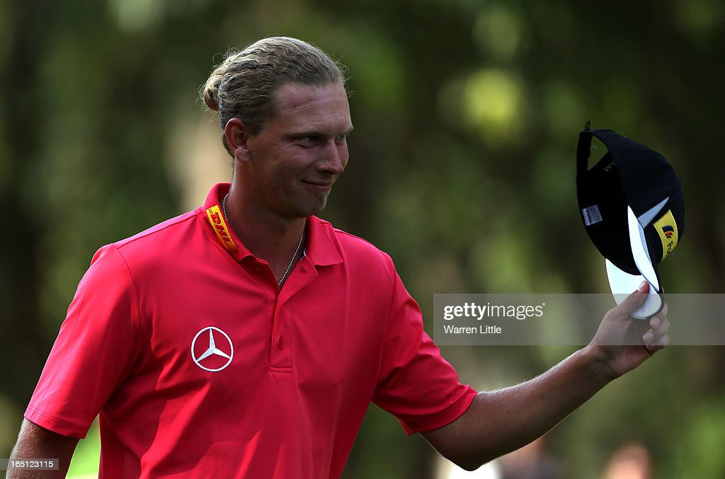 <a gi-track='captionPersonalityLinkClicked' href=/galleries/search?phrase=Marcel+Siem&family=editorial&specificpeople=167180 ng-click='$event.stopPropagation()'>Marcel Siem</a> of Germany acknowledges the crowd on the 18th green after winning the Trophee du Hassan II Golf at Golf du Palais Royal on March 31, 2013 in Agadir, Morocco.