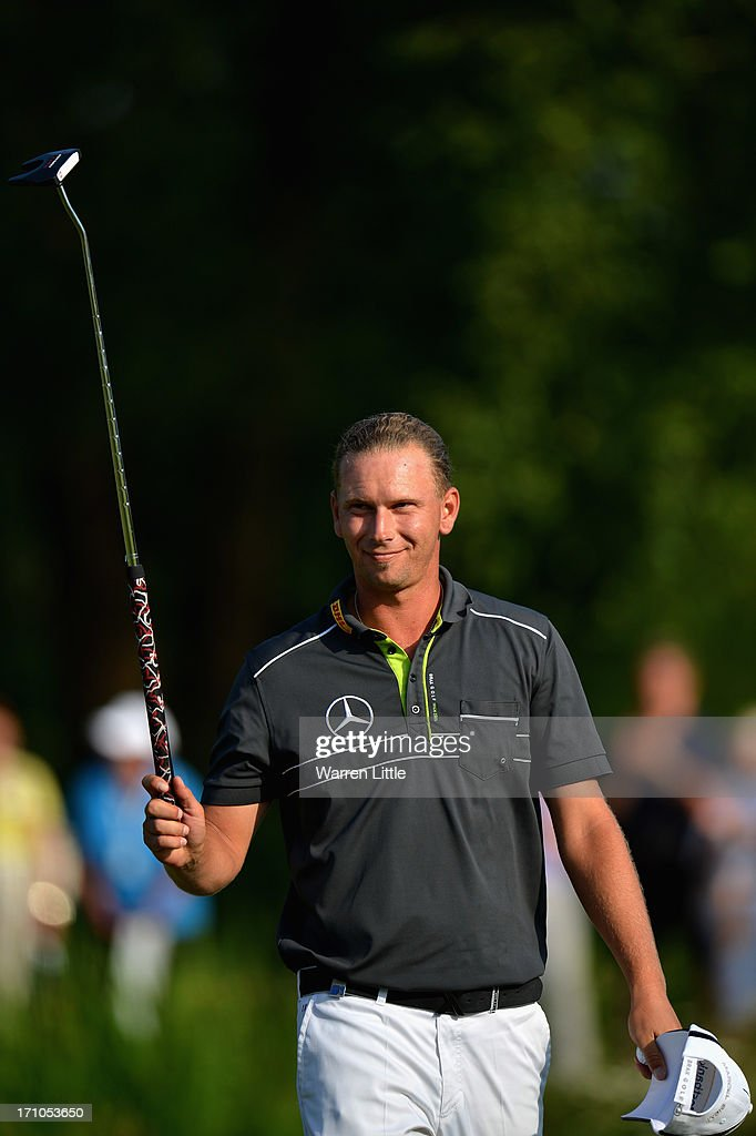<a gi-track='captionPersonalityLinkClicked' href=/galleries/search?phrase=Marcel+Siem&family=editorial&specificpeople=167180 ng-click='$event.stopPropagation()'>Marcel Siem</a> of Germany acknowledges the crowd on the 18th green during the second round of the BMW International Open at Golfclub Munchen Eichenried on June 21, 2013 in Munich, Germany.