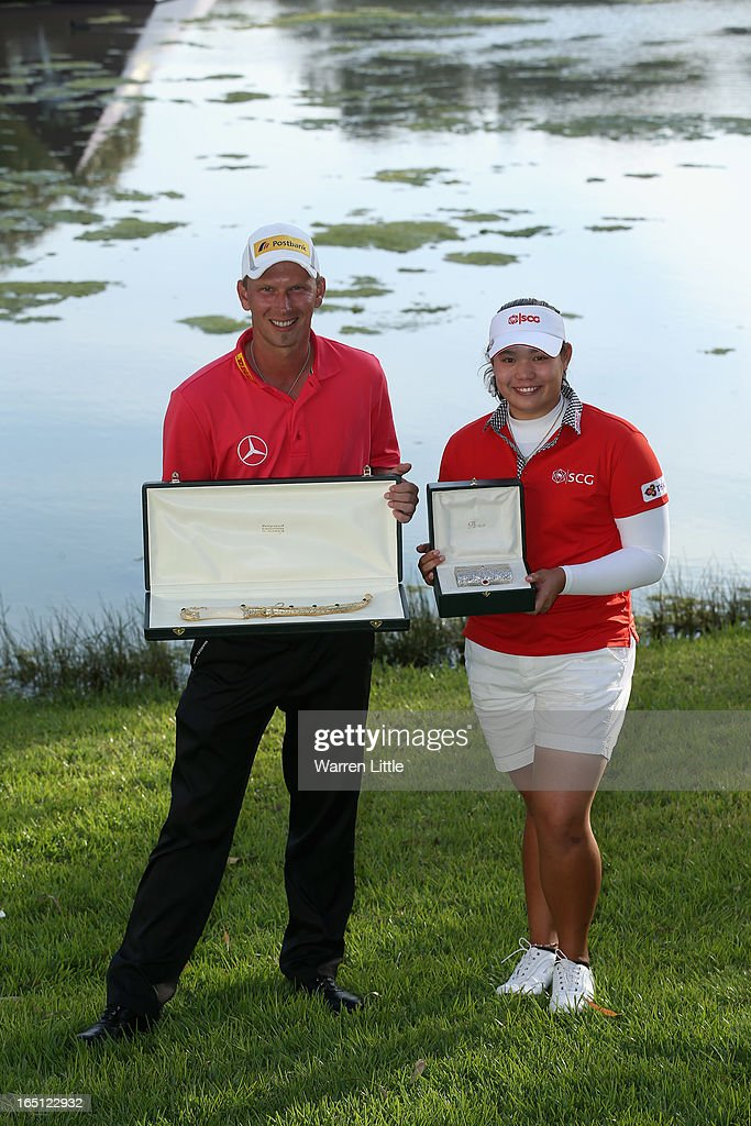Marcel Siem of Germany and Ariya Jutanugarn of Thailand pose their trophies after the Trophee du Hassan II Golf at Golf du Palais Royal on March 31, 2013 in Agadir, Morocco.