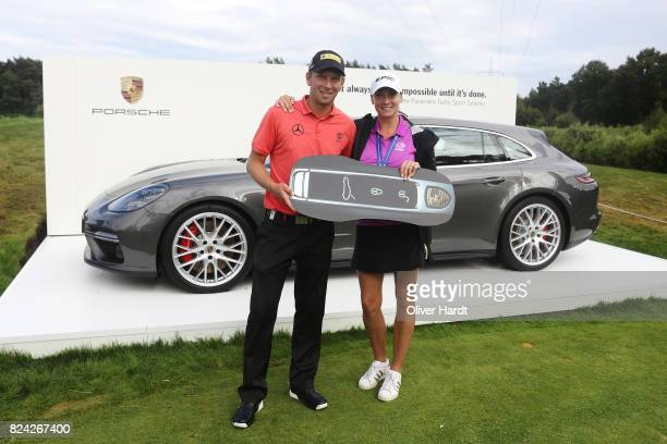 Marcel Siem of Germany and his wife poses with his price after making a hole in one on the 17th hole during the Green Eagle Golf Course on July 29...