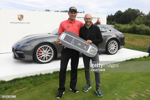 Marcel Siem of Germany and Oliver Eidam Director of Brands Partnerships and Sponsoring at the Porsche AG receive his price at Porsche Panamera Sport...