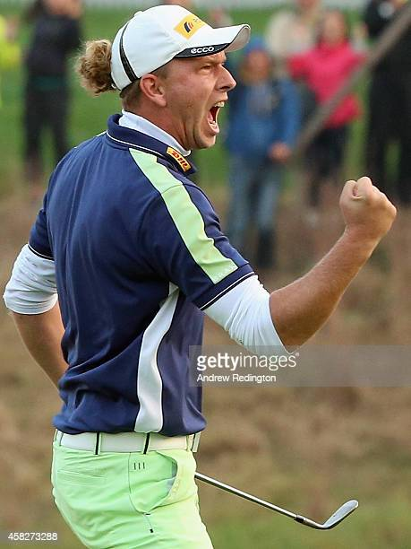 Marcel Siem of Germany celebrates after chipping in for a birdie at the first playoff hole on his way to victory in the BMW Masters at Lake Malaren...