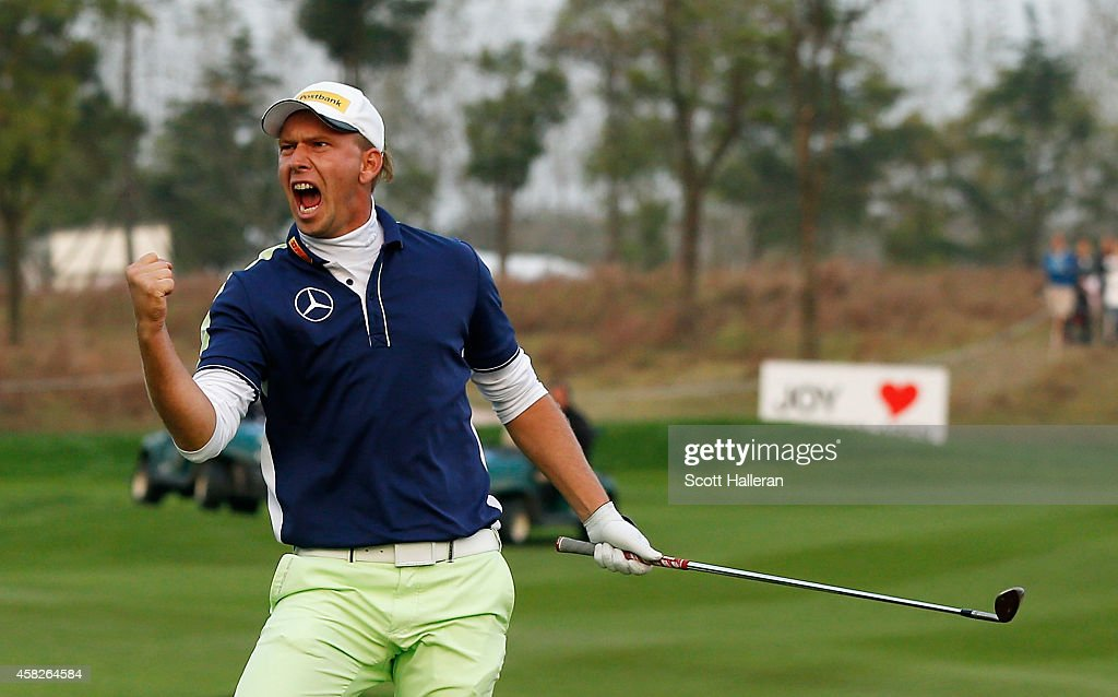 Marcel Siem of Germany celebrates after he chipped in for birdie on the first playoff hole during the final round of the BMW Masters at Lake Malaren...