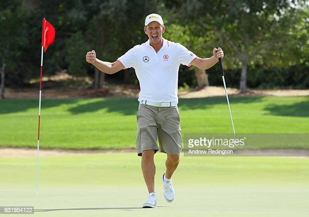 Marcel Siem of Germany celebrates during the Pro Am event prior to the start of the Abu Dhabi HSBC Golf Championship at Abu Dhabi Golf Club on...