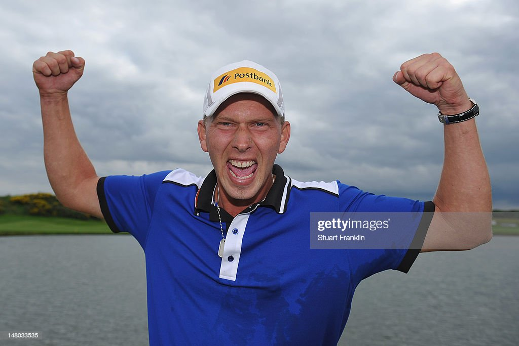 Marcel Siem of Germany celebrates winning after the final round of the Alstom Open de France at Le Golf National on July 8 2012 in Paris France