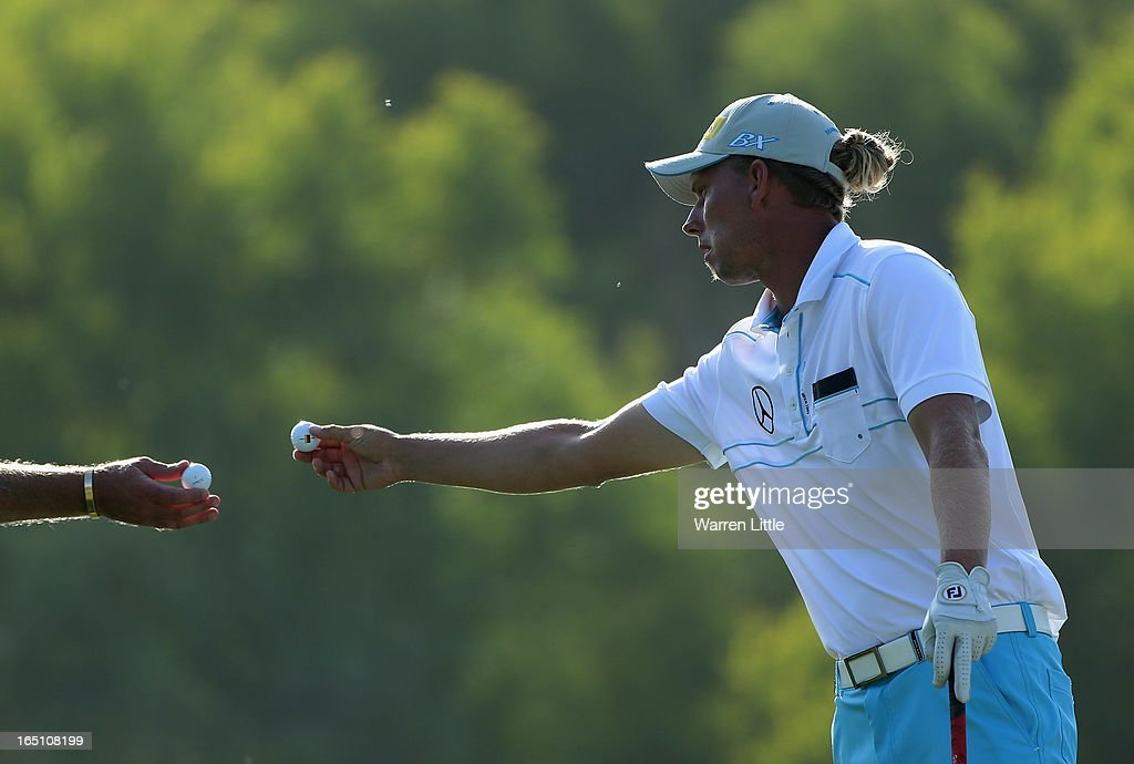 <a gi-track='captionPersonalityLinkClicked' href=/galleries/search?phrase=Marcel+Siem&family=editorial&specificpeople=167180 ng-click='$event.stopPropagation()'>Marcel Siem</a> of Germany exchanges balls with his caddie during the third round of the Trophee du Hassan II at Golf du Palais Royal on March 30, 2013 in Agadir, Morocco.