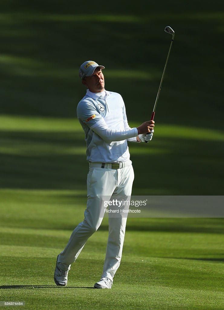 Marcel Siem of Germany hits his 3rd shot on the 4th hole during day one of the BMW PGA Championship at Wentworth on May 26, 2016 in Virginia Water, England.