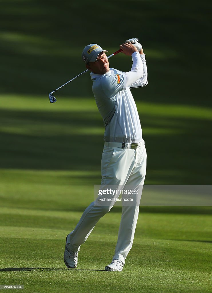 <a gi-track='captionPersonalityLinkClicked' href=/galleries/search?phrase=Marcel+Siem&family=editorial&specificpeople=167180 ng-click='$event.stopPropagation()'>Marcel Siem</a> of Germany hits his approach on the 4th hole during day one of the BMW PGA Championship at Wentworth on May 26, 2016 in Virginia Water, England.