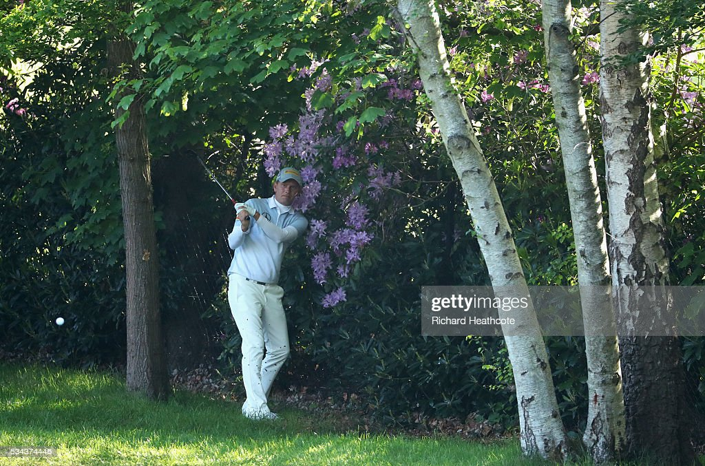 Marcel Siem of Germany hits out of trouble on the 4th hole during day one of the BMW PGA Championship at Wentworth on May 26, 2016 in Virginia Water, England.