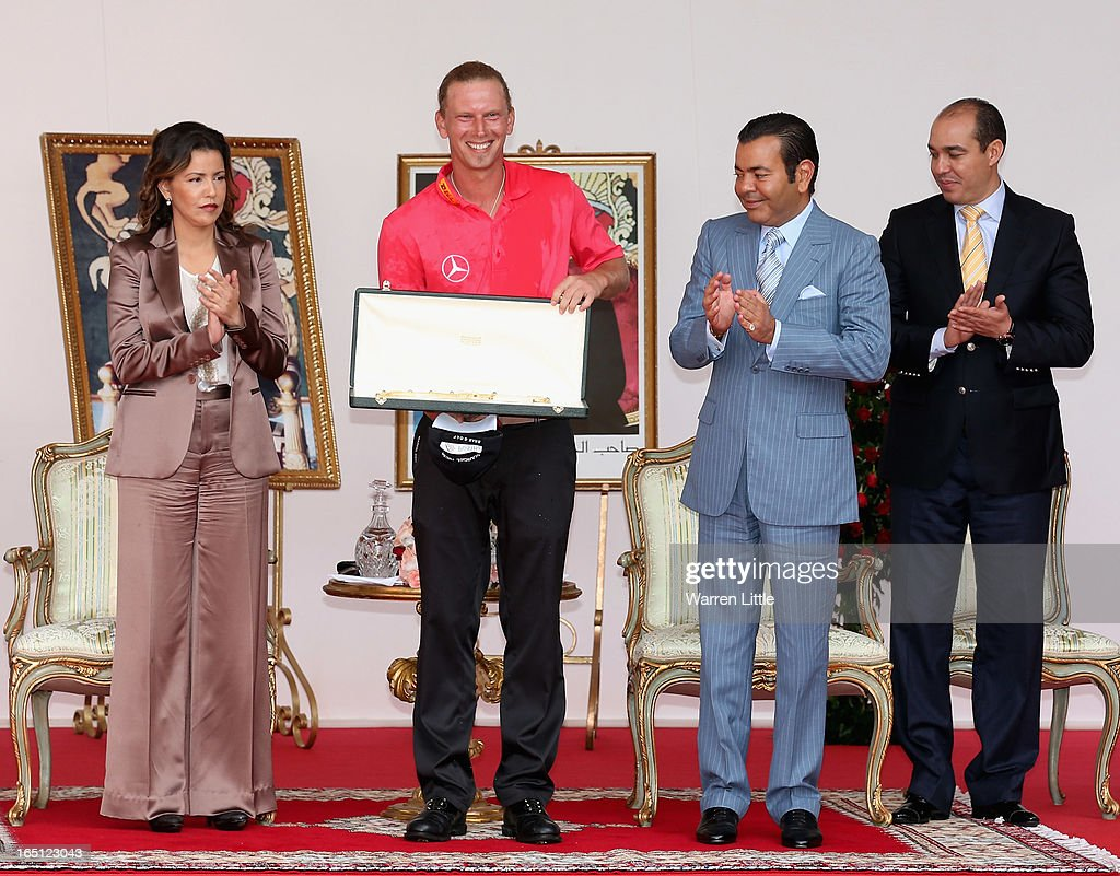 Marcel Siem of Germany is awarded the trophy by HRH Prince Moulay Rachid after winning the Trophee du Hassan II Golf on a score of -17 under par at Golf du Palais Royal on March 31, 2013 in Agadir, Morocco.