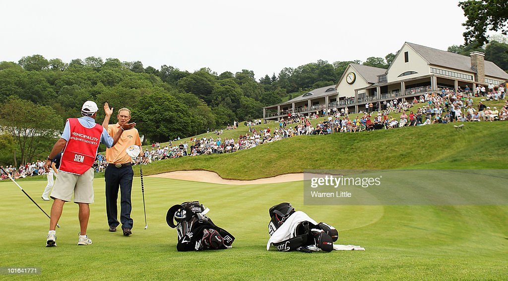 Marcel Siem of Germany is congratulated by his caddie Kyle Roadley on the 18th green during the third round of the Celtic Manor Wales Open on The Twenty Ten Course on June 5, 2010 in Newport, Wales.