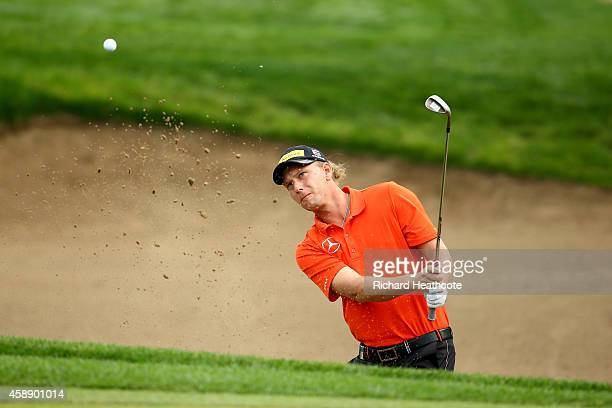 Marcel Siem of Germany plays from a greenside bunker on the 10th during the first round of the 2014 Turkish Airlines Open at The Montgomerie Maxx...