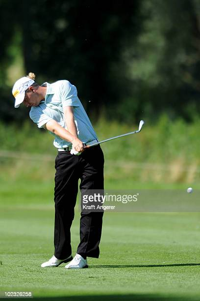 Marcel Siem of Germany plays his second shot into the 11th green during the ProAm of The BMW International Open Golf at The Munich North Eichenried...