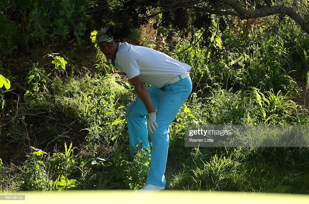 Marcel Siem of Germany plays out of the trees near the 17th green during the third round of the Trophee du Hassan II at Golf du Palais Royal on March 30, 2013 in Agadir, Morocco.