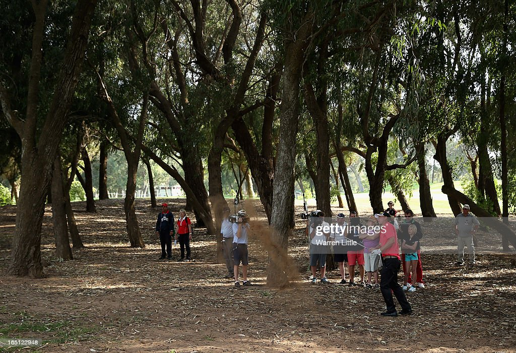 Marcel Siem of Germany plays out of the trees on the 18th hole during the final round of the Trophee du Hassan II Golf at Golf du Palais Royal on March 31, 2013 in Agadir, Morocco.