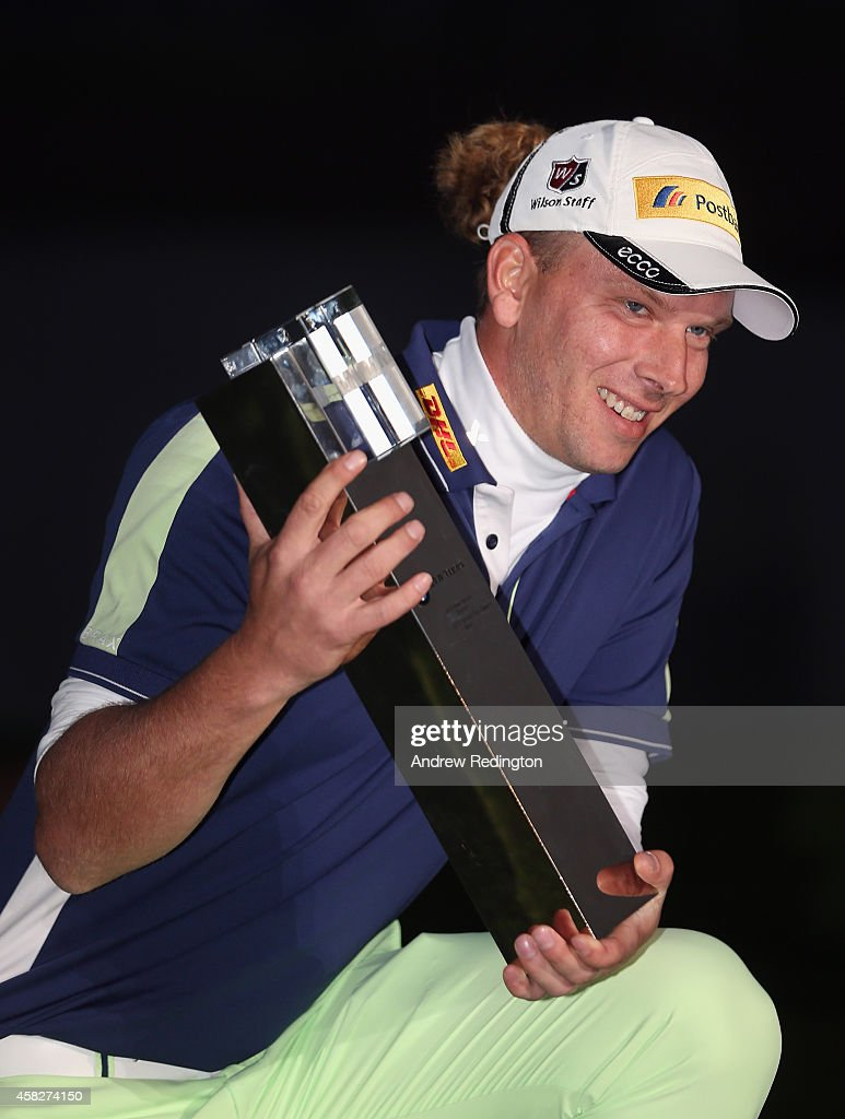 Marcel Siem of Germany poses with the trophy after winning the BMW Masters at Lake Malaren Golf Club on November 2 2014 in Shanghai China