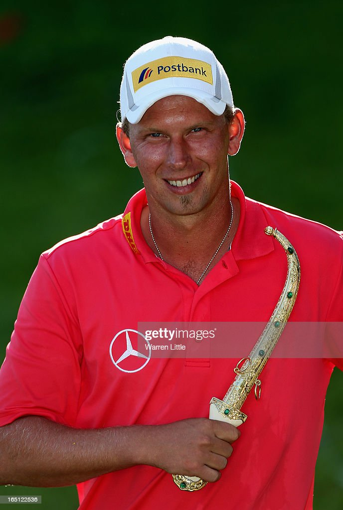 <a gi-track='captionPersonalityLinkClicked' href=/galleries/search?phrase=Marcel+Siem&family=editorial&specificpeople=167180 ng-click='$event.stopPropagation()'>Marcel Siem</a> of Germany poses with the trophy dagger after winning the Trophee du Hassan II Golf on a score of -17 under par at Golf du Palais Royal on March 31, 2013 in Agadir, Morocco.