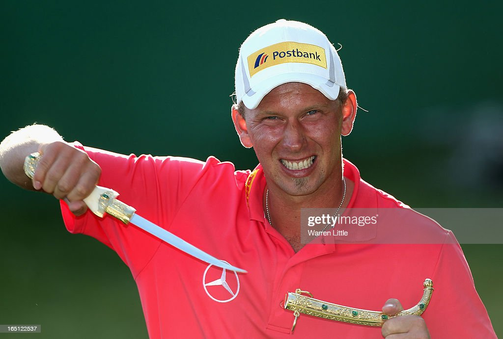 Marcel Siem of Germany poses with the trophy dagger after winning the Trophee du Hassan II Golf on a score of -17 under par at Golf du Palais Royal on March 31, 2013 in Agadir, Morocco.