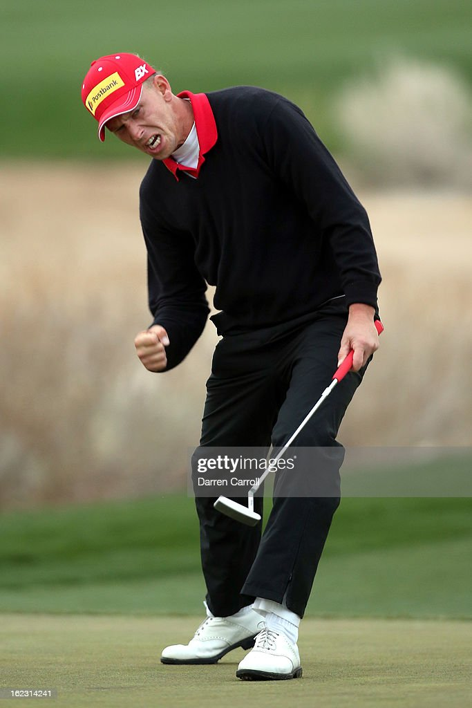 Marcel Siem of Germany reacts after he made a birdie putt on the 17th hole green during the first round of the World Golf Championships - Accenture Match Play at the Golf Club at Dove Mountain on February 21, 2013 in Marana, Arizona. Round one play was suspended on February 20 due to inclimate weather and is scheduled to be continued today.