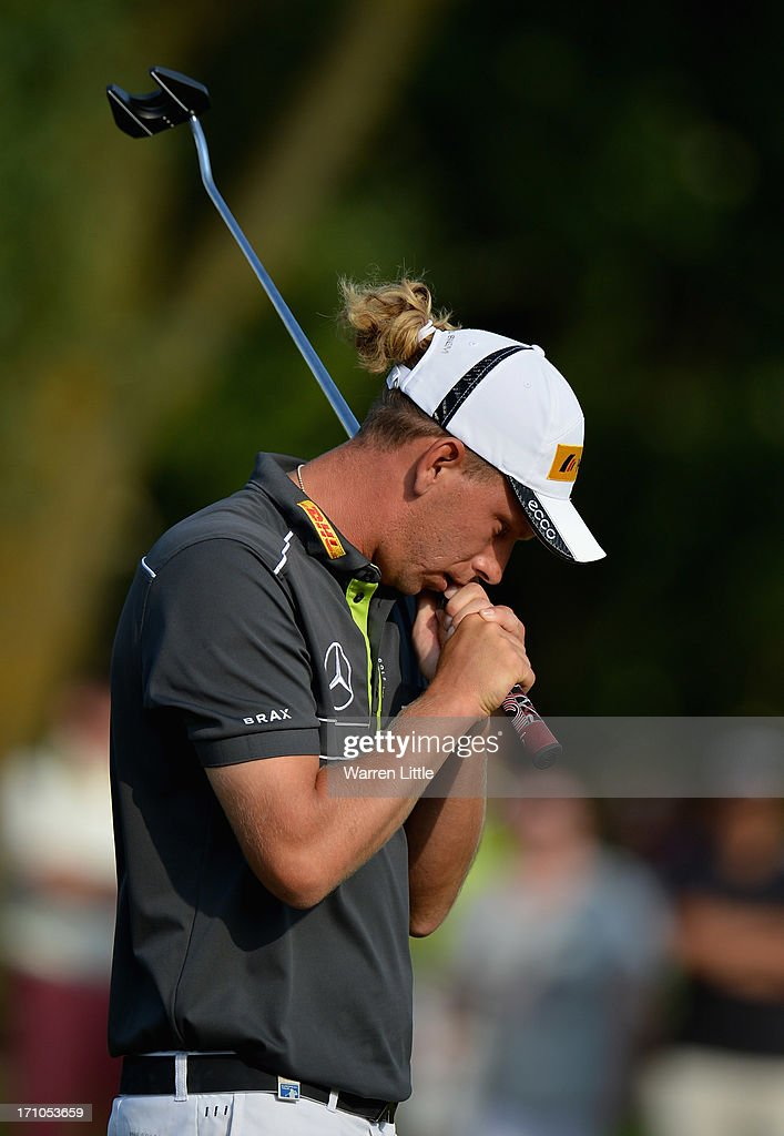 <a gi-track='captionPersonalityLinkClicked' href=/galleries/search?phrase=Marcel+Siem&family=editorial&specificpeople=167180 ng-click='$event.stopPropagation()'>Marcel Siem</a> of Germany reacts on the 18th green during the second round of the BMW International Open at Golfclub Munchen Eichenried on June 21, 2013 in Munich, Germany.